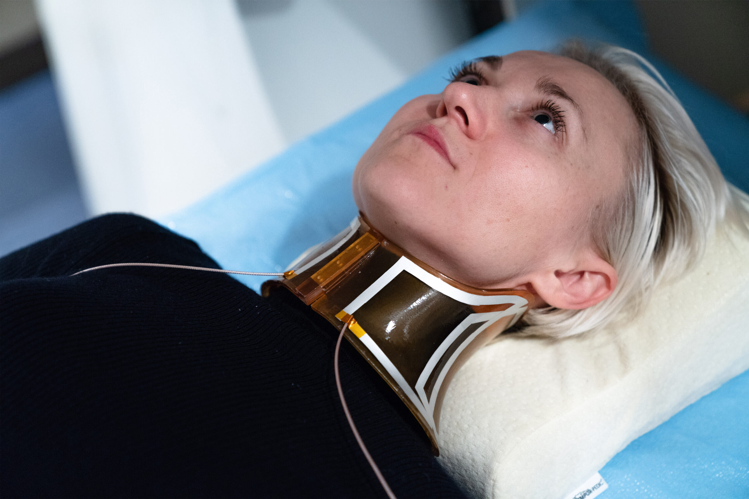 Patient wearing a personalized neck coil for MRI imaging